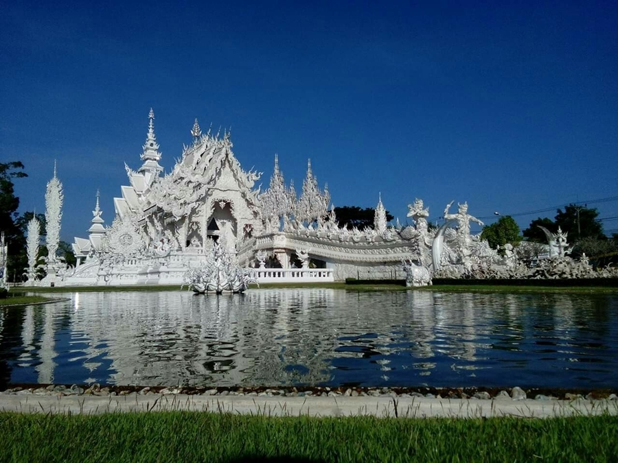 Chiang Rai + White Temple + Blue Temple + Golden Triangle + Hilltribes + Long Neck Village.