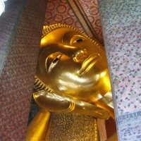 The face of the biggest reclining Buddha in Thailand. www.chiangmaitourcenter.com