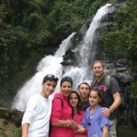 Family photo in front of the waterfall.