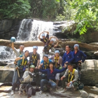 Group photo with the lovely waterfall. www.chiangmaitourcenter.com