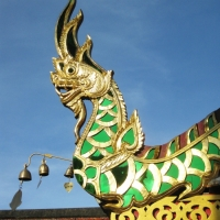 The Naga decoration in colored mirror on the roof top of the building at Doi Suthep Temple. www.chiangmaitourcenter.com