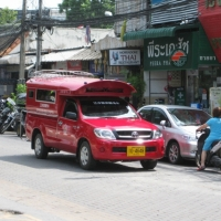 The local red taxi which could take you around Chiang Mai. www.chiangmaitourcenter.com